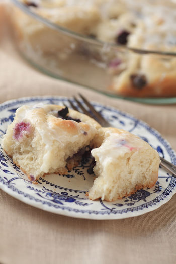 Close-Up Of Blueberry Sweet Roll Served In Plate On Table
