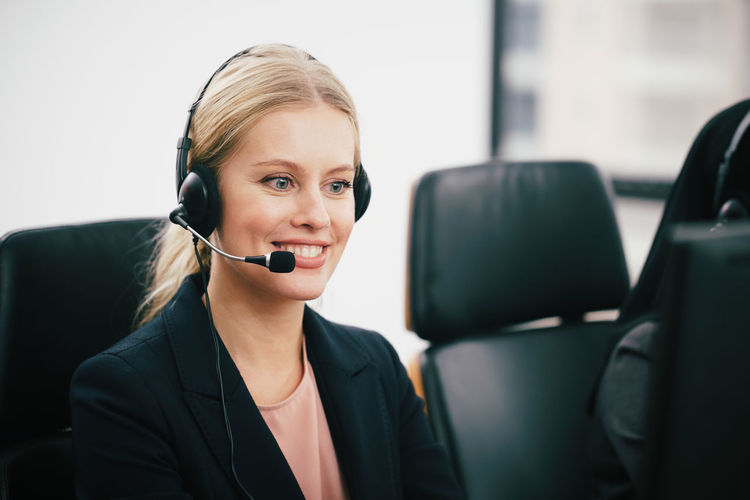 Close-up of call center employee with headset at office