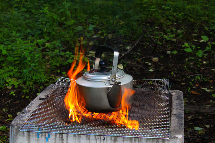 Close-up of kettle over fire pit