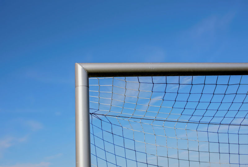 football goal Football Goal Barrier Blue Boundary Built Structure Clear Sky Close-up Copy Space Day Fence Low Angle View Metal Nature Net - Sports Equipment No People Outdoors Protection Safety Security Sky Sunlight