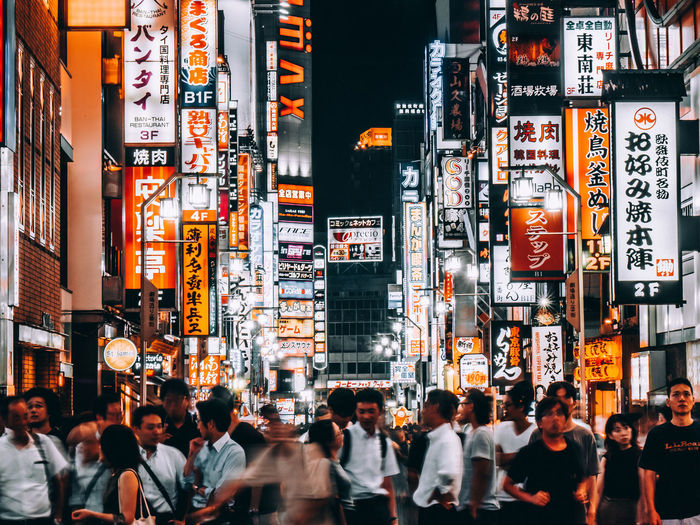 Advertisement Architecture Billboard Building Exterior Built Structure City City Life Communication Crowd Group Of People Illuminated Large Group Of People Men Neon Night Non-western Script Outdoors Real People Script Sign Street Text
