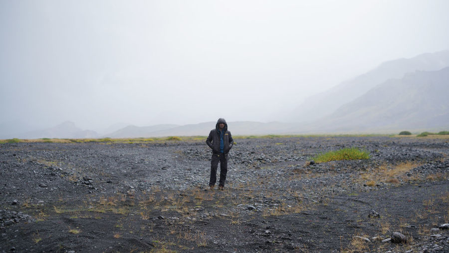 Man standing in remote area in iceland Iceland Travel Adult Adventure Beauty In Nature Day Fog Full Length Hiking Landscape Lifestyles Mountain Nature One Person Outdoors People Real People Rear View Scenics Sky Standing Tranquil Scene Tranquility