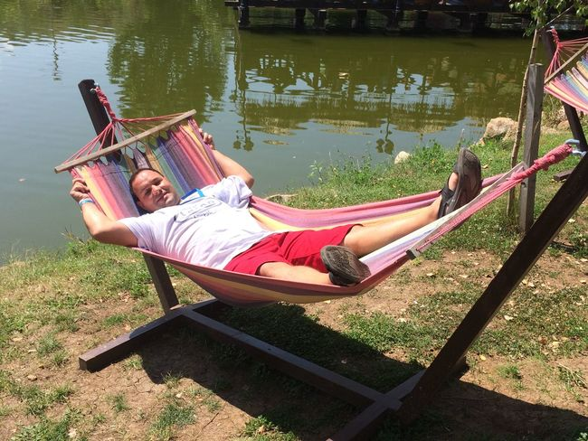 Casual Clothing Childhood Day Full Length Grass Hammock Lake Leisure Activity Lifestyles Mode Of Transport Nautical Vessel Outdoors Person Relaxation River Sitting Transportation Water