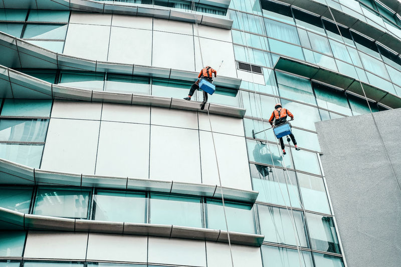 Low angle view of men cleaning building
