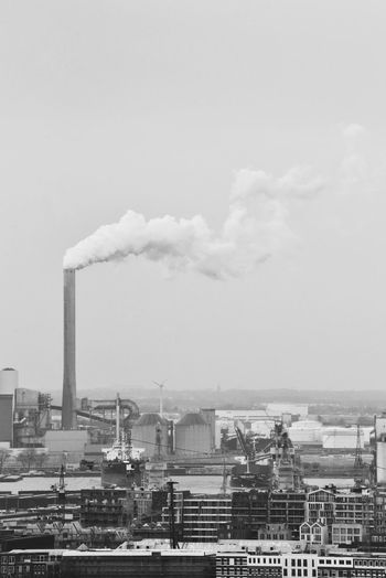 """""""Foggy Future"""" How Do You See Climate Change? How Do We Build The World? Environment Environmental Issues Eye4photography  EyeEm Gallery Blackandwhite City Cityscape Sky And Clouds Horizon Over Land City Factory Industry Smoke Stack Sky Architecture Building Exterior Built Structure Air Pollution Smoke Heat Chimney Global Warming Emitting Fumes Power Station Pollution Atmospheric Environmental Damage"""