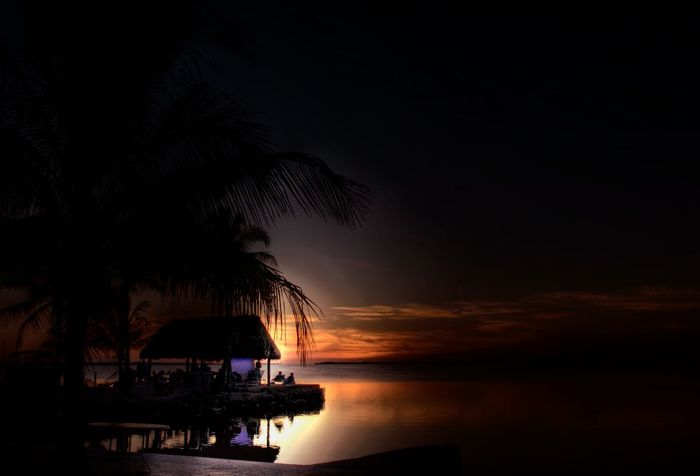 Sunset in the Florida Keys. Beauty In Nature Calm Dark Florida Keys Horizon Over Water Idyllic Majestic Nature Non-urban Scene Ocean Orange Color Outdoors Reflection S Scenics Sea Silhouette Sky Sunset Tranquil Scene Tranquility Vacations Water Waterfront