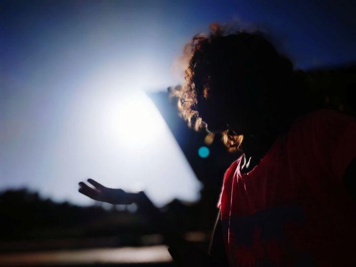 Silhouette woman gesturing against sky
