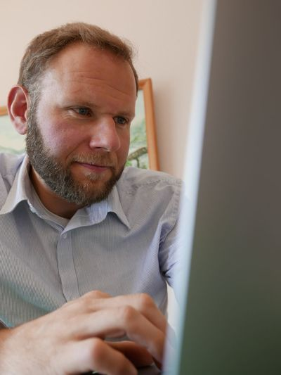 Mid Adult Man Using Computer