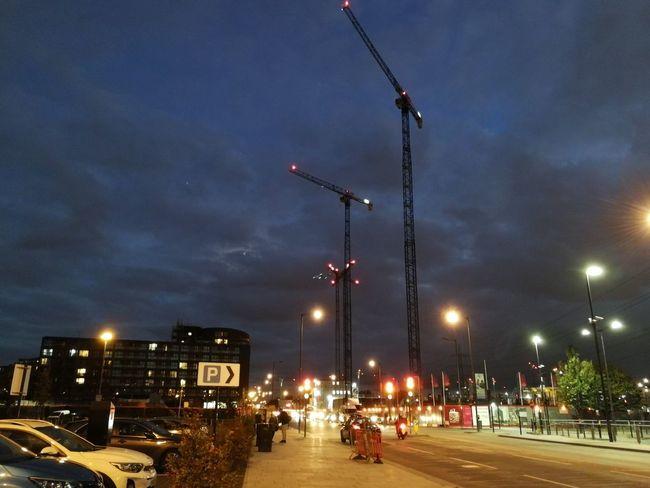Crane - Construction Machinery City Illuminated Cityscape Street Light Street Sky Traffic Vehicle Red Light Traffic Light