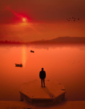 Sunset Silhouette Reflection Full Length People Standing Business Finance And Industry One Man Only One Person Sky Outdoors Adult Only Men Nautical Vessel Men Red Water Adults Only Nature Bird Riyadhphotographer EyeEm Team EyeEm Masterclass Azzydoon Travel