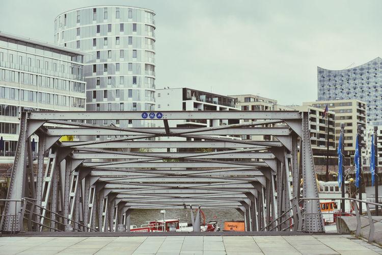 View of bridge in city against sky