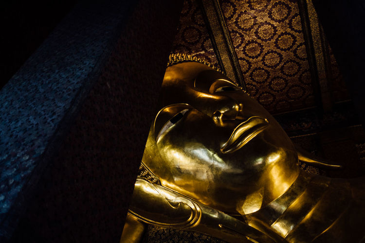reclining buddha, wat pho, bangkok Wat Pho Art And Craft Close-up Day Gold Gold Colored Human Representation Indoors  Low Angle View Male Likeness No People Reclining Buddha Religion Sculpture Spirituality Statue