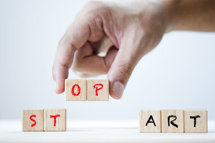 Human hand array Start and stop keyword on wooden cubic. This is wording conceptual create symbol to success concept. Advice Attitude Awareness Background Beginning Belief Brain Business Chance Change Choice Clever Closeup Coaching Concept Creative Do Finger Go Goal Hand Idea Imagination Initiative Intelligence Keyword Life Make Management Message Mind  Mindset Motivation Opportunity Positive Psychology Set Sign Start Starter Stop Strategy Success Successful Symbol Text Think Vision Wooden Word
