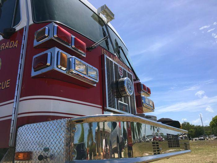Firefighters fire trucks tTransportationsSkydDayoOutdoorslLand VehiclenNo PeoplepPublic TransportationcCloud - SkyaArchitecturelLow Angle ViewfFire EnginenNature