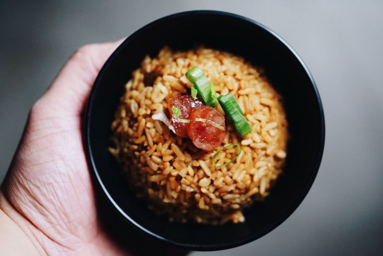 Cropped Image Of Person Holding Rice In Bowl