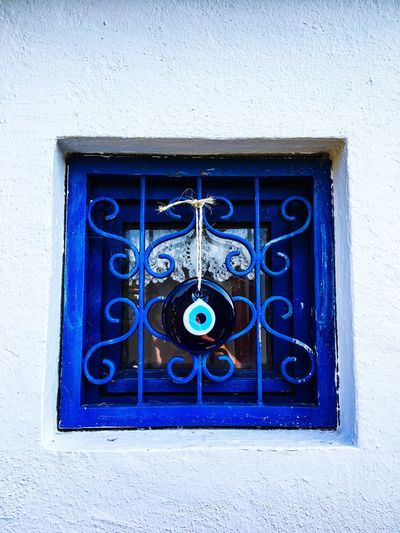 Evileye Evil Eye Turkey Nazar Cultures Wall - Building Feature Blue Architecture No People Building Exterior Built Structure Day Close-up Window Wall Metal Closed Building Outdoors Safety Protection Security White Color Shape Old