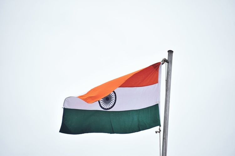 Indian Flag Waving Against Clear Sky