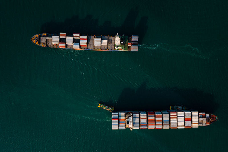 Aerial top view two container cargo ship in import export business service and industry