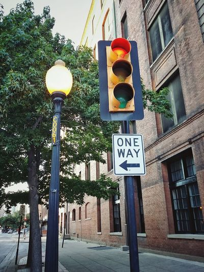 one way Lamp Post Street Light City Street Photography Road Sign Tree Guidance Communication One Way Text Architecture Building Exterior Sky Built Structure Traffic Arrow Sign Directional Sign Arrow Sign