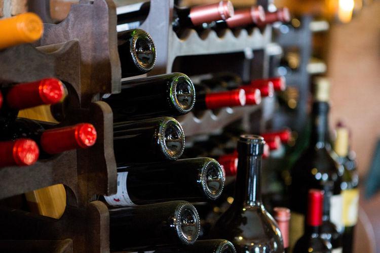 Wine bottles on rack at store