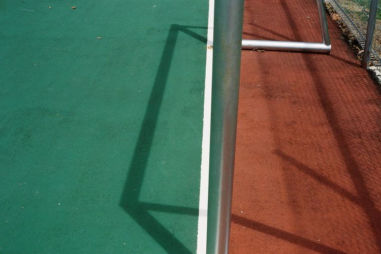 High angle view of a goal post and its shadow