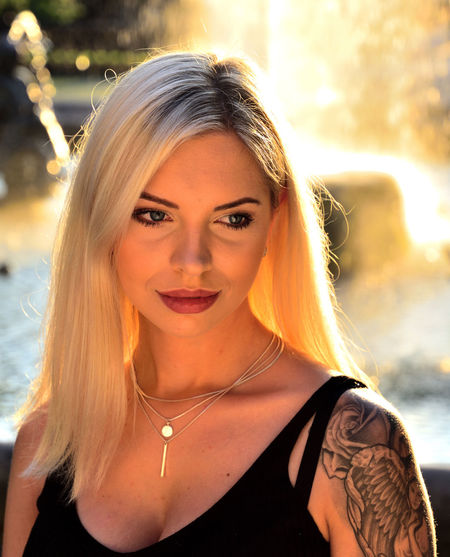 Sophia Tattooed Tattoo ❤ Tattoed Girl  Golden Hour Bokeh Photography Portrait Of A Woman Portrait Photography Fountain Atmosphere Blond Hair Young Women Portrait Beautiful Woman Beautiful People Looking At Camera Headshot Beauty Front View Necklace The Portraitist - 2019 EyeEm Awards