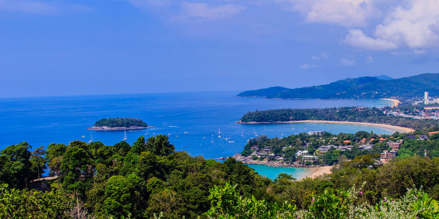 Beautiful seascape of turquoise ocean waves with boats, coastline and blue sky background from high aerial view point of Kata and Karon beaches in Phuket Thailand. Aerial View Of Beach Coastline Coastline Landscape Karon Beach, Phuket Karon Beach, Phuket, Thailand Kata Beach Kata Beach,Phuket Thailand Kata Beach Phuket, Thai Seascape Photography Aerial View Aerial View Of City Architecture Beauty In Nature Blue Coastal Coastal Landscape Coastline Beauty Coastline Sky Day High Angle View Horizon Over Water Karon Beach Karon View Point Karon Viewpoint Kata Kata Noi Beach Mountain Nature No People Outdoors Scenics Sea Seascape Seascape Skyscape Sky Tranquility Turquoise Turquoise Sea Water