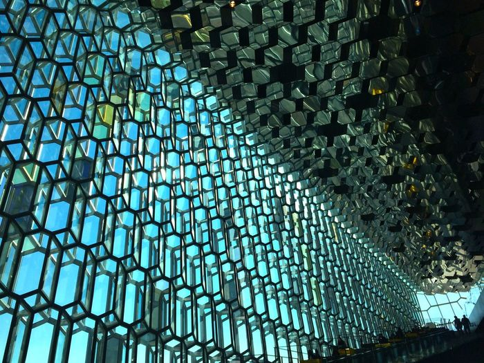 Harpa Harpa Reykjavik Architecture Glass Façade Honeycomb Honeycombs Low Angle View Reflection Reykjavik Architecture Blue Color Mediterrane Building Interior Built Structure Concert Hall  Day Geometrical Patterns Glass Glowing Harpa Concert Hall Harpa Music Hall Indoors  Modern Pattern Shiluette Sunlight And Shadow Two People Window