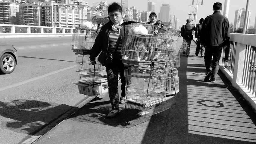 China View Streetphotography People Black And White RePicture Giving Hello World Worker Portrait Vanishing Point The Human Condition Showcase: December B&w Street Photography Street Life Street Vendors Seeing The Sights