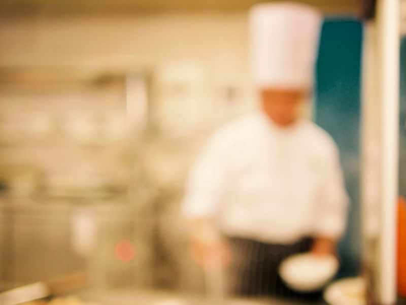 Apron Copy Space Meal White Dress Blurry Background Blurry Lighting Of Chef Working Inside Hotel Restaurant Cooking Time Costume For Chef Day Focus On Foreground Hotel Breakfast Indoors  Lifestyles Men One Person People Real People Rear View Restaurant Soft Focus Editing Standing White Hat