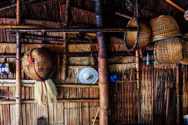Stack of wicker basket hanging in hut