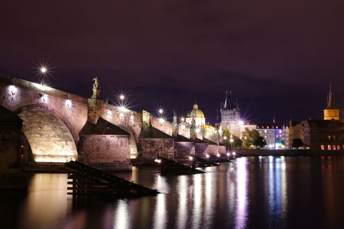 Architecture Bridge - Man Made Structure Building Exterior Built Structure Charles Bridge City City Gate Cityscape Cultures History Horizontal Illuminated Karlův Most Night No People Outdoors Reflection River Sky Travel Travel Destinations Urban Skyline Water Waterfront