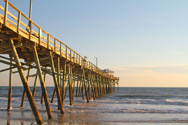 Outer Banks, NC Architecture Beach Beauty In Nature Blue Built Structure Clear Sky Day Diminishing Perspective Horizon Over Water Nature No People Outdoors Pier Scenics Sea Sky Tranquil Scene Tranquility vanishing point Water