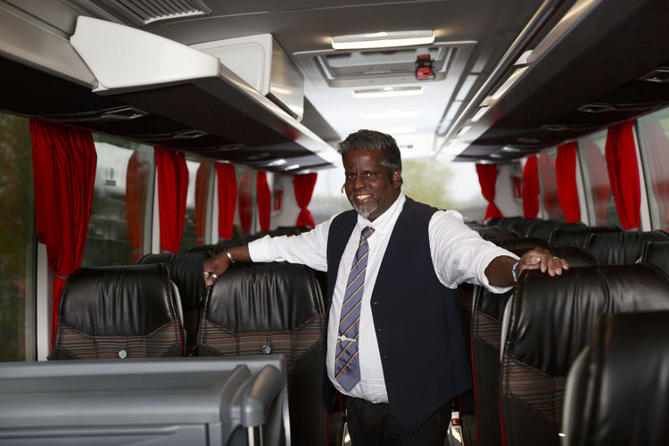 Portrait of man standing in bus