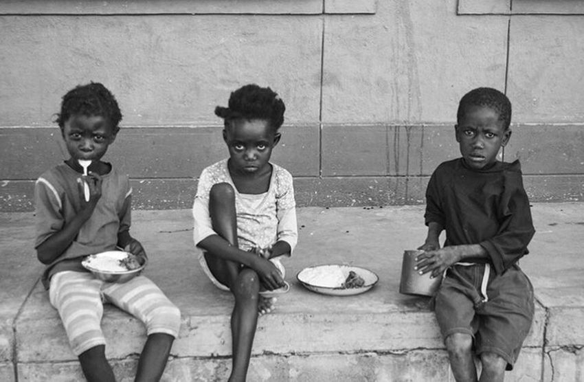 The Photojournalist - 2016 EyeEm Awards Children in Namibia benefit from local hunter's humanitarian efforts. A hunter kills a wildebeest and uses every part of the animal to create food and build shelter for struggling villages. Namibia Children Children Photography Poverty Starvation Malnourished Africa Blackandwhitephoto Hunter Wildebeest Hunting Hiv Touching