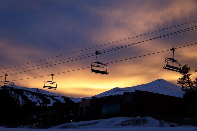 Snow Winter Cold Temperature Sky Weather Cable Sunset Nature Scenics Cloud - Sky Ski Lift Beauty In Nature Low Angle View Power Line  Overhead Cable Car Mountain No People Mountain Range Outdoors Ski Resort  Snowboarding