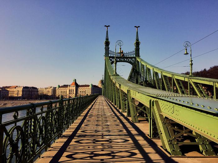 View of footbridge against clear sky
