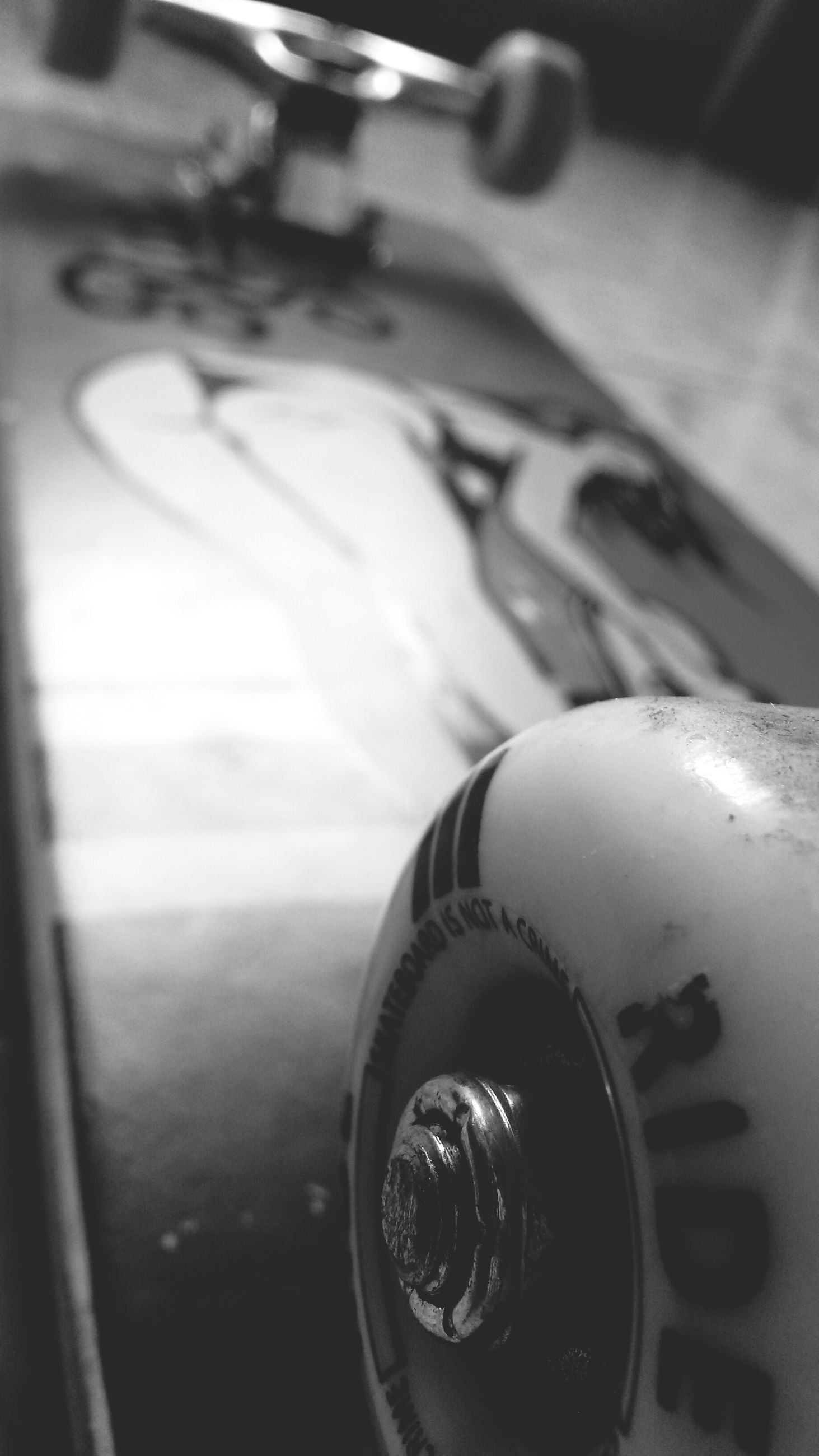 close-up, indoors, focus on foreground, still life, selective focus, part of, technology, single object, no people, metal, cropped, high angle view, transportation, equipment, shiny, day, old-fashioned, table, man made object, detail