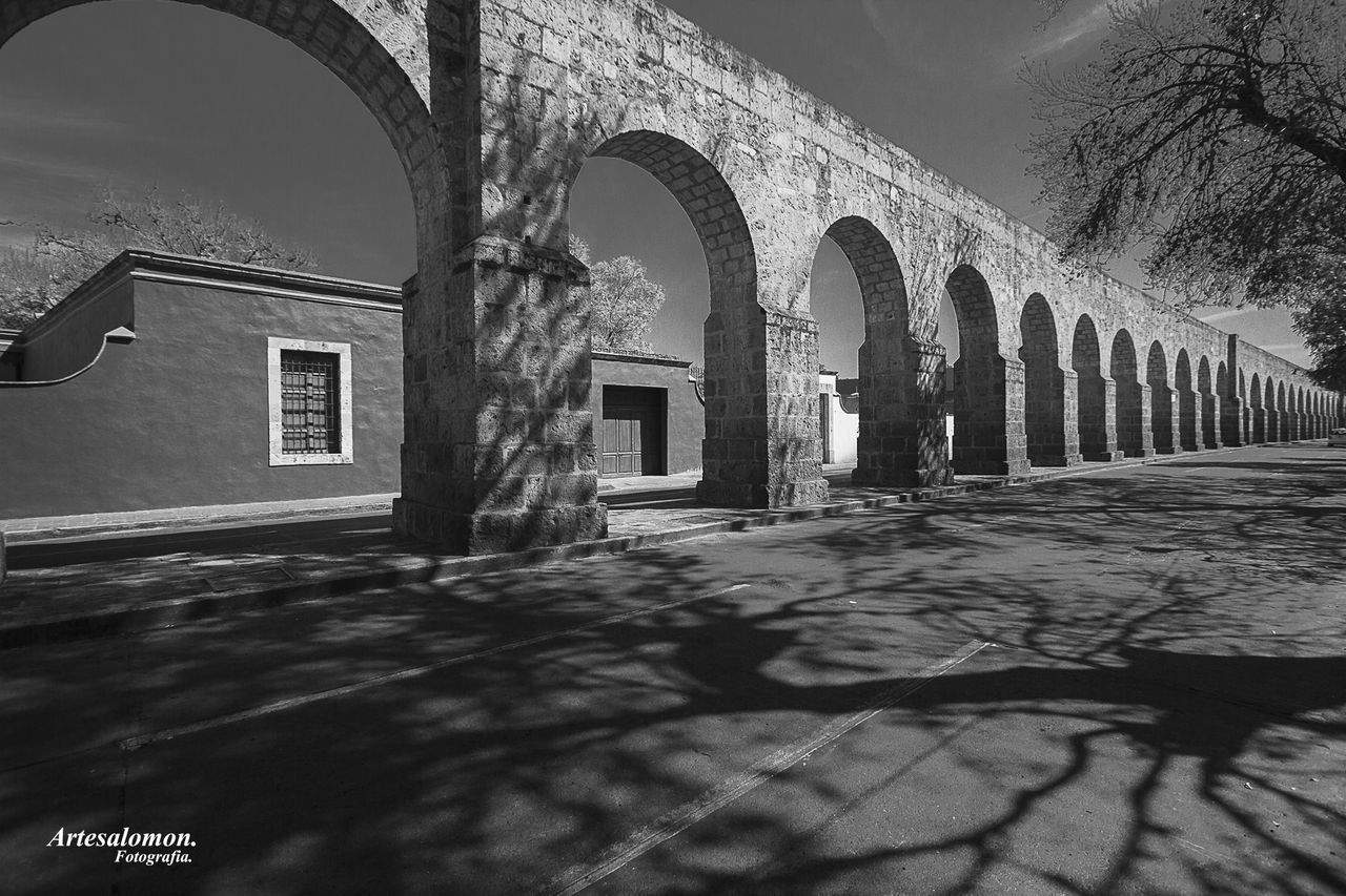 architecture, built structure, arch, building exterior, history, the past, building, day, nature, shadow, no people, architectural column, outdoors, religion, sunlight, water, arcade, old, belief, place of worship, arched, courtyard, surface level, colonnade