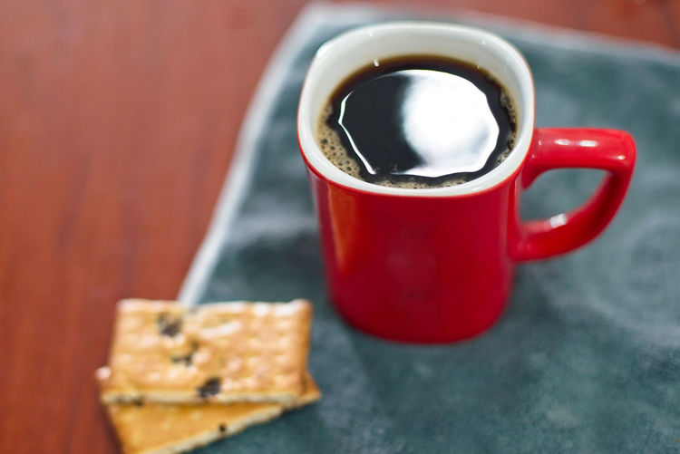 Baked Biscuit Breakfast Close-up Coffee Coffee - Drink Coffee Cup Cracker Crockery Cup Drink Focus On Foreground Food Food And Drink Freshness Hot Drink Indoors  Mug No People Non-alcoholic Beverage Red Refreshment Snack Still Life Sweet Food Table Tea Cup