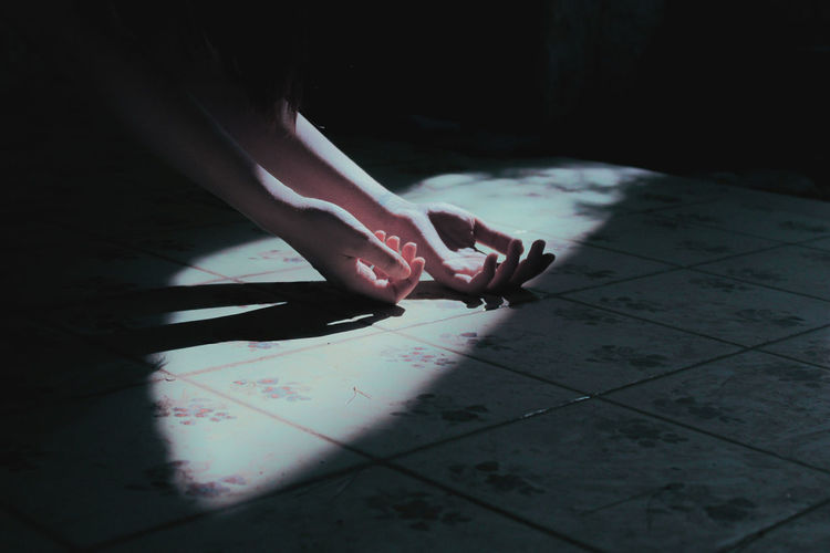 Human Hand Low Section Shadow Spooky Domestic Life Mystery Tiled Floor barefoot Wet Capture Tomorrow