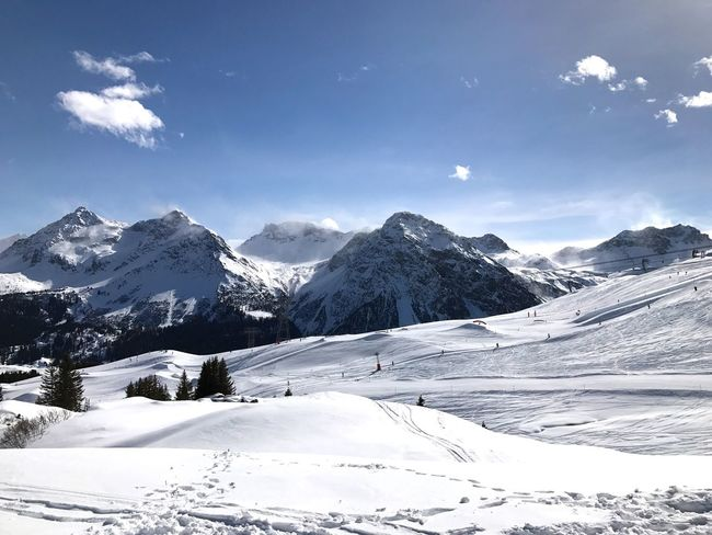 Snow Cold Temperature Winter Mountain Sky Nature Beauty In Nature Outdoors Day No People Ski Holiday Non-urban Scene Snowcapped Mountain Clouds And Sky Scenics Landscape Winter Nature Beauty In Nature Skiing Mountain Range Tranquility Adventure Tourism Idyllic