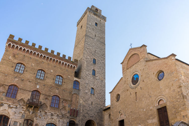 The towers in San Giminano, Italy San Gimignano Tuscany Architecture Blue Building Building Exterior Built Structure Clear Sky Clock Day History Italy Low Angle View Nature No People Outdoors Sky The Past Tourism Tower Travel Travel Destinations Window