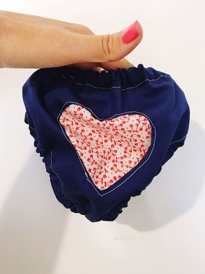 One Person Human Hand Holding Human Body Part Real People Indoors  White Background Close-up Day People Sewing Sewing Stuff Homemade Design Textile Pattern Heart Shape Textured  Textures And Surfaces Sewing Item Baby Clothing Diper