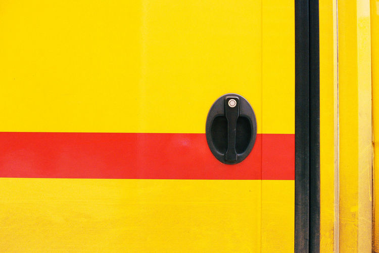 Closed yellow bus door