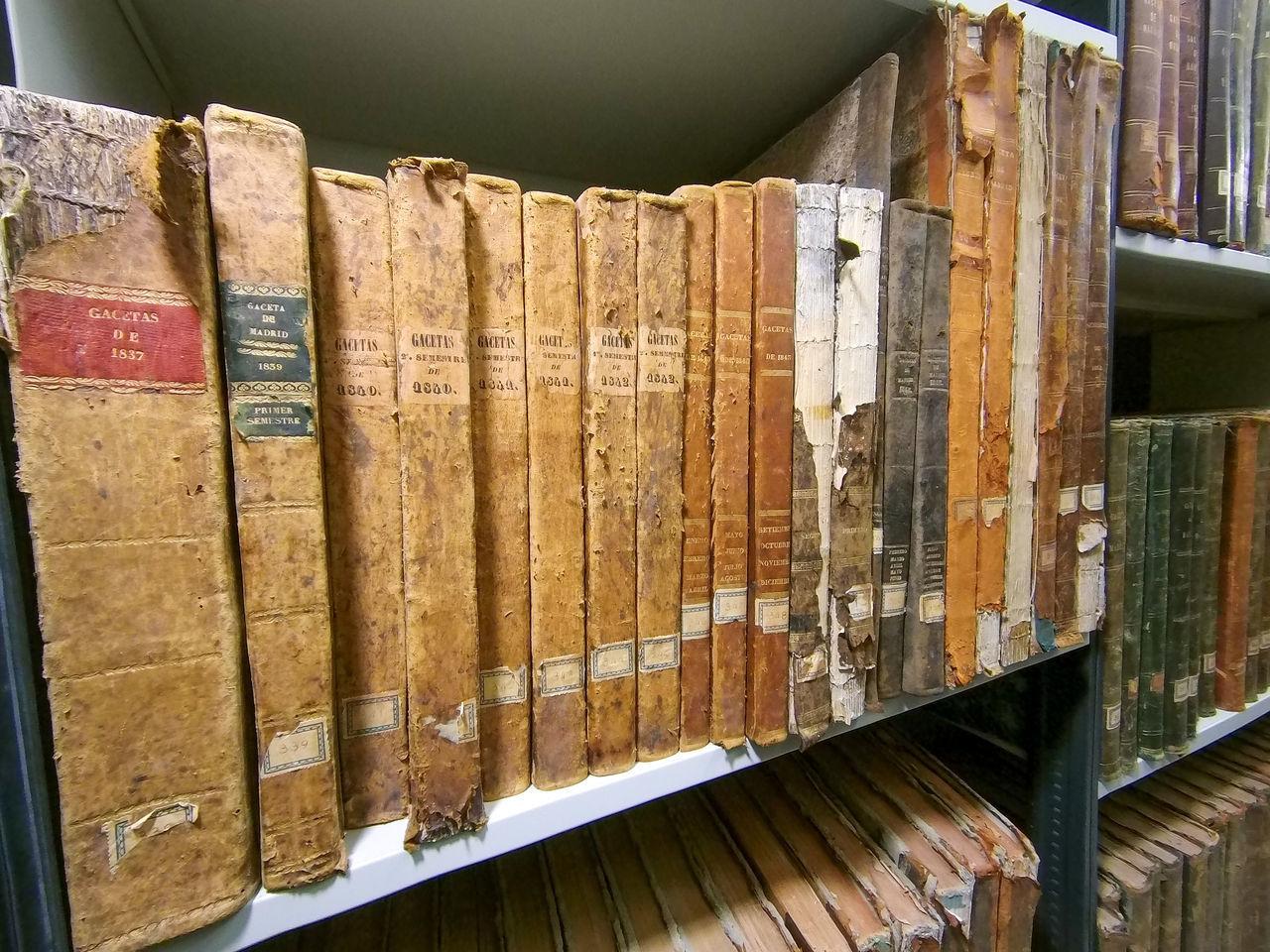 CLOSE-UP OF OLD BOOKS IN SHELF