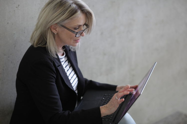 Business Woman Business Person One Person Business Glasses Eyeglasses  Technology Adult Communication Businesswoman Women Wireless Technology Blond Hair Holding Hair Well-dressed Office Looking Young Adult Corporate Business Hairstyle