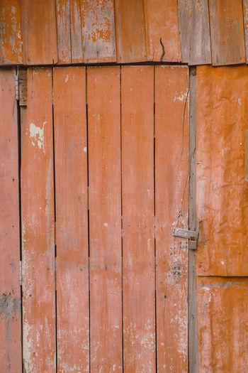 Full frame shot of weathered wooden door