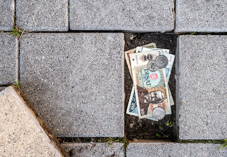 Czechoslovak koruna banknotes and coins found under a loose pavement brick. Concept of finding already defunct currency Stash Hidden Money Hidden Secret Money Czechoslovakia Koruna Crown Defunct Currency Vintage Vintage Money Paving Stone Stone Found Stumbled Upon Treasure Hidden Treasure