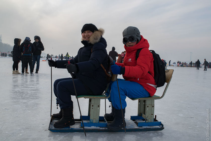 DREAM TEAM (China, Heilongjiang, Harbin, January 2017) ASIA China Chinese Cold Temperature Fun Harbin Heilongjang Ice Festival Ice Hockey Ice Rink Ice Rink Ice Skating Iced Iced River Leisure Activity People Pollution Sitting Skating Snow Songhua River Travel Week-end Winter Winter Sport